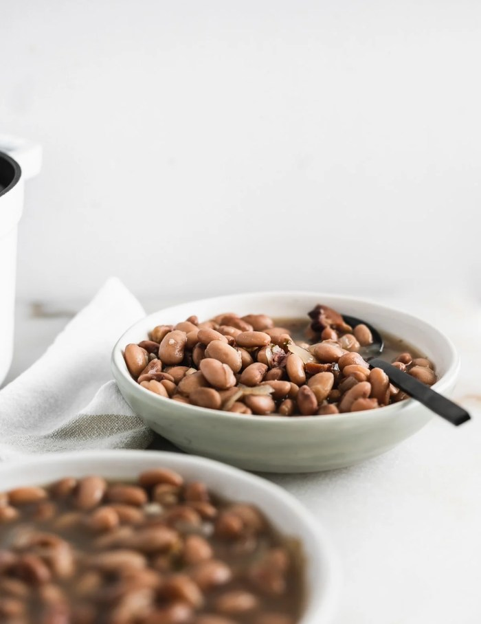 The best easy pinto beans from scratch, with stovetop and slow cooker directions. They are an easy, flavorful and healthy side dish to go with all of your Tex-Mex, Mexican, and BBQ meals, or a simple, hearty vegetarian dinner. (gluten-free, dairy-free, vegetarian option)