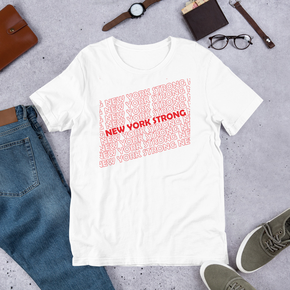 White t-shirt on the floor showing New York Strong in Red block capitals