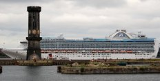 Ruby Princess glides past the six-sided clock