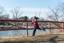 A boy tries to throw a stone across the Rappahannock.