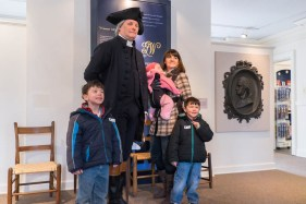 George Washington (Greg Fisher) greets a visiting family.