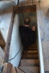 Leaving the attic down a narrow staircase.