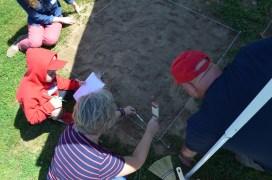 Taking soil depth measurements before digging.