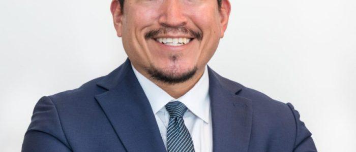 Eric Delgado is President of the Orange Line Living Team