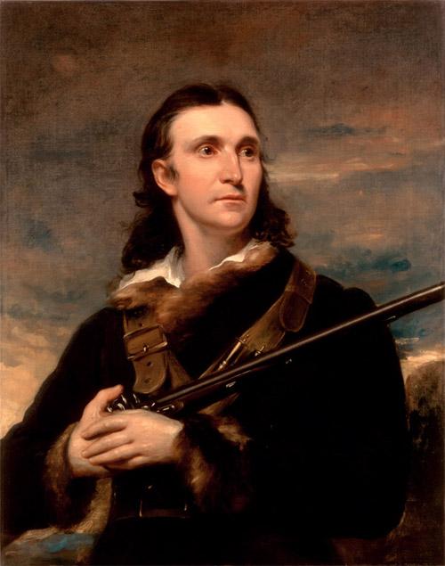 Målning som föreställer konstnären John James Audubon. Han syns i halvfigur mot en mörk himmel och har ett gevär i händerna.