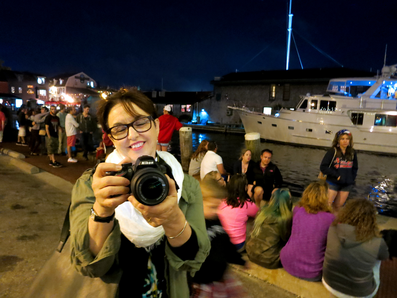 ROCKET'S RED GLARE OVER NEWPORT HARBOR - live. travel. adventure. bless. | Julia taking a picture of Bowen's Wharf in Newport, RI just before the start of the Newport Harbor fireworks display. Happy 4th of July!