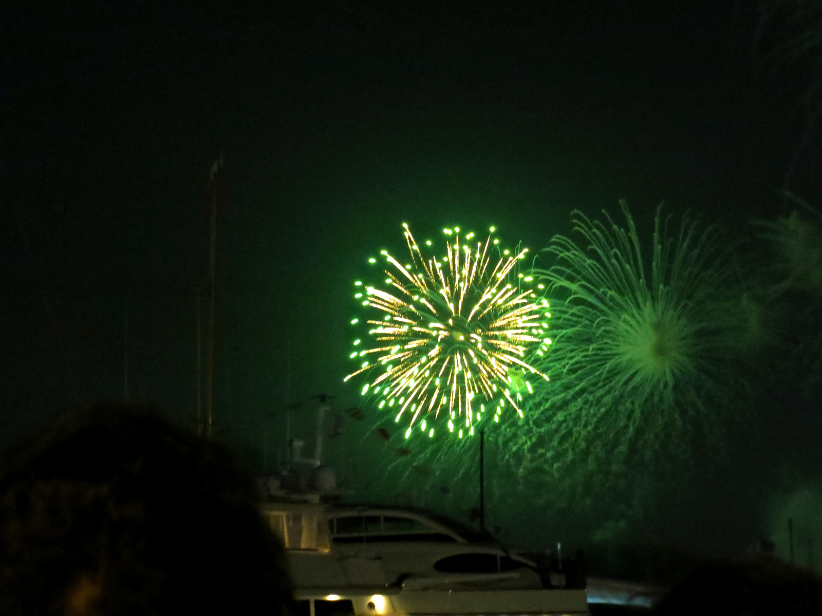 ROCKET'S RED GLARE OVER NEWPORT HARBOR - live. travel. adventure. bless. | Green firework lighting up the sky in Newport Harbor in Newport, RI. Happy 4th of July!