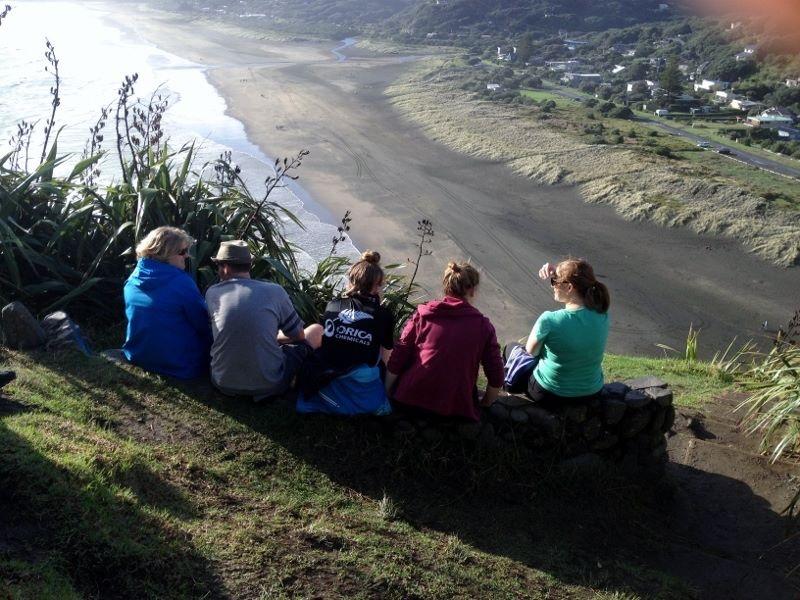 Overlooking a black sand beach in NZ's North Island