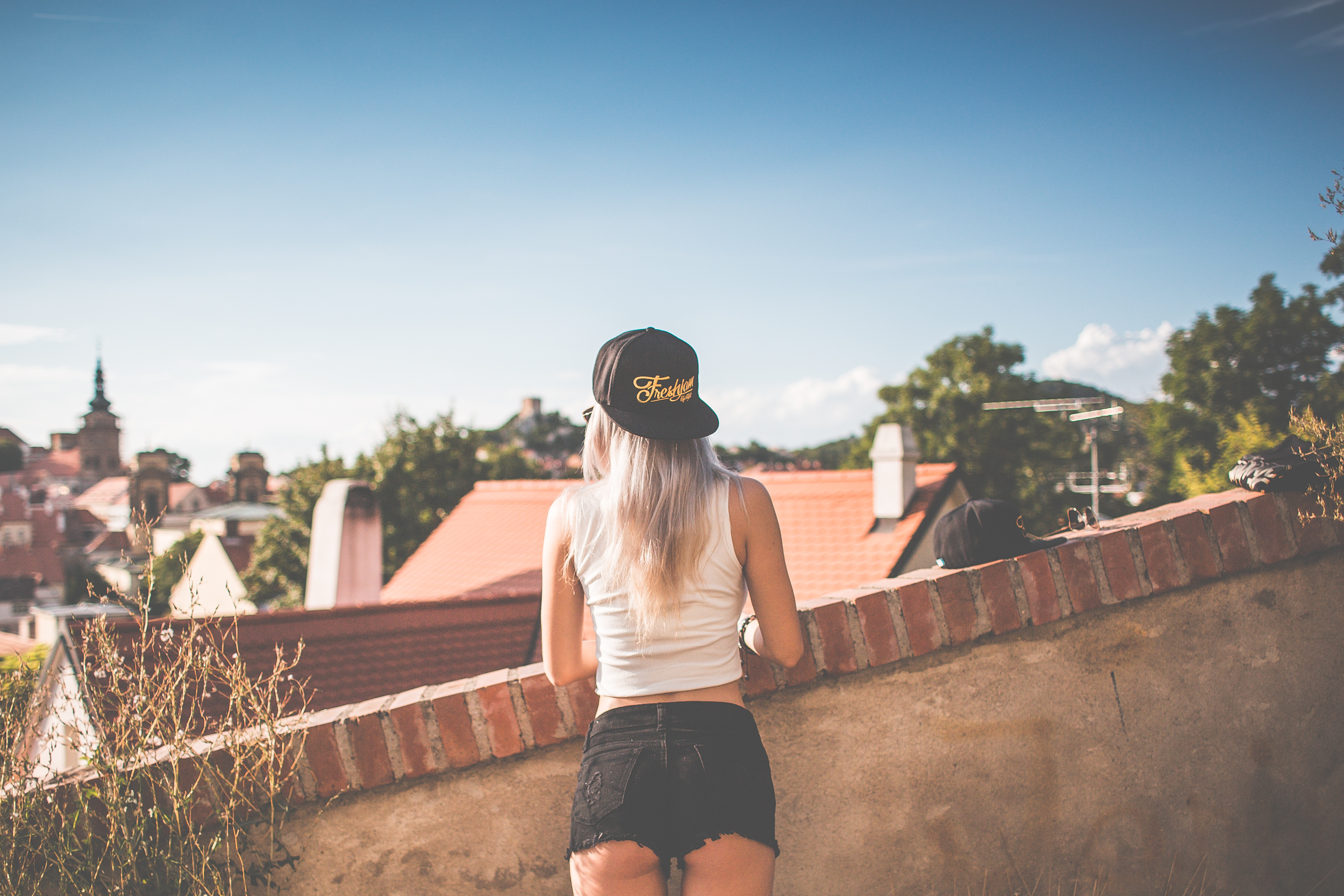 young-girl-with-snapback-looking-over-the-old-city-picjumbo-com