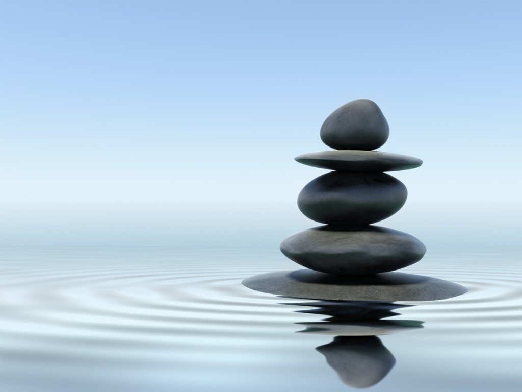 Zen stones in water with reflection