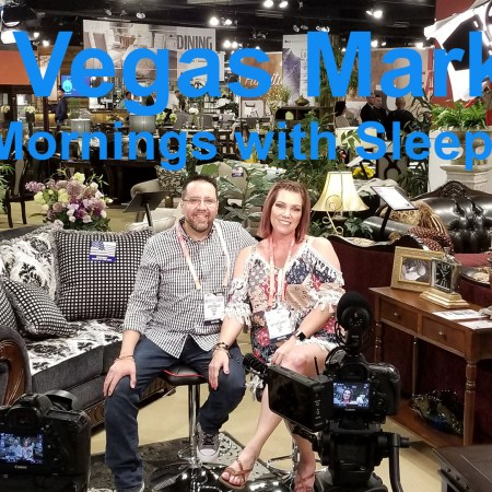 Javier Casillas and Gretchen Casillas pose for camera at Furniture of America showroom during a video shoot.