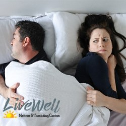 Live Well Mattress & Furnishing Woman in Bed struggling with blanket hog husband