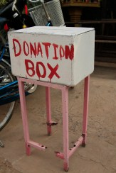the donation box has seen better days, but serves its purpose of keeping the school funded