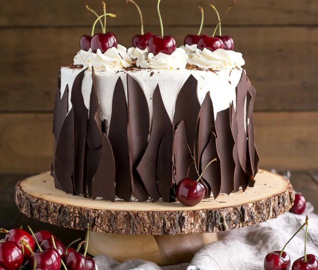 This Black Forest Cake Combines Rich Chocolate Cake Layers With Fresh Cherries Cherry Liqueur And A Simple Whipped Cream Frosting