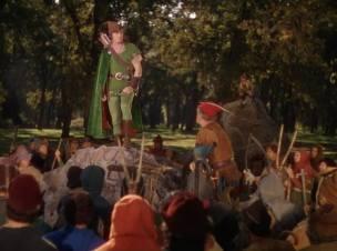 Revoltado com as medidas, Robin Hood conversa com os homens da floresta sobre uma batalha contra as injustiças