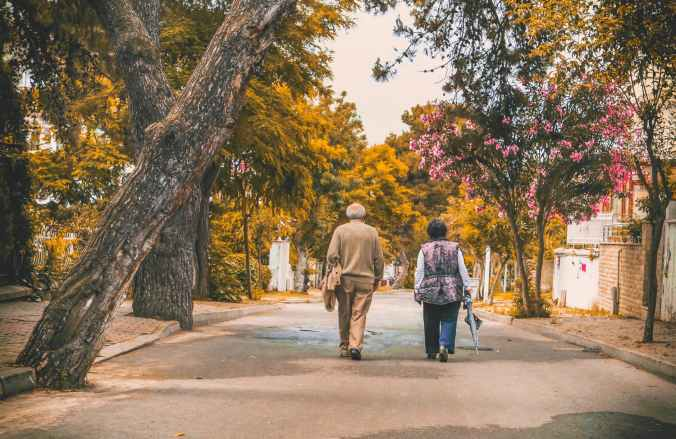 man and woman walking on the street