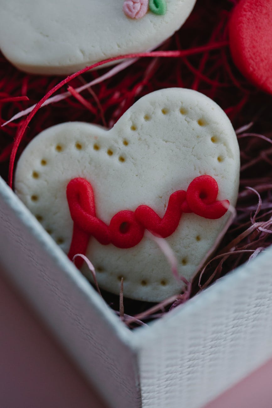 heart shaped cookie with love inscription
