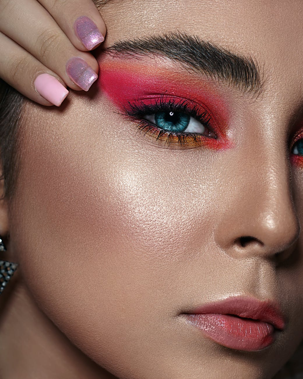 close up photo of woman with pink eyeshadow