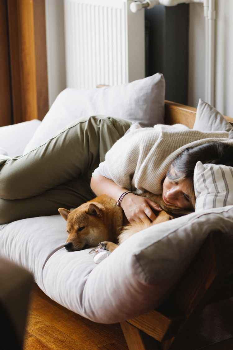 the power of rest - woman and dog napping