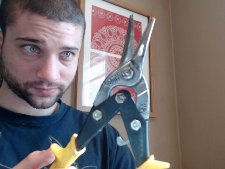 These tin snips worked great, but people usually use a hacksaw, then sand down the edge.
