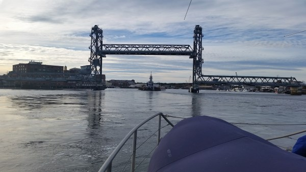 Center span of the bridge being lifted for boat traffic