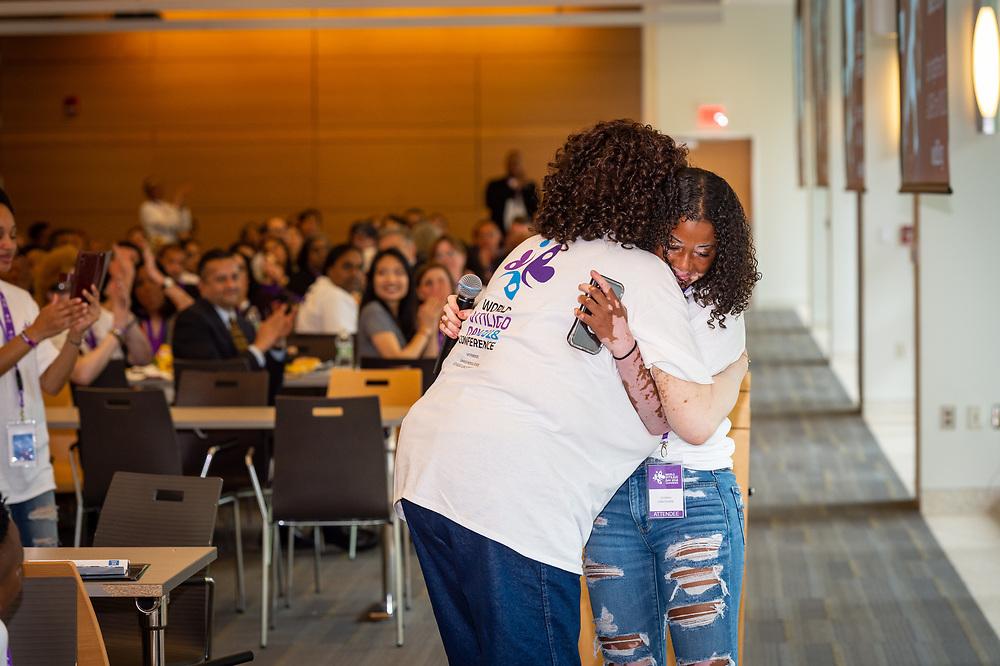 JáHirah Hawthorne receives a hug after her speech.