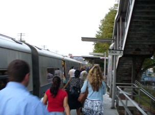 Commuters walking next to a train