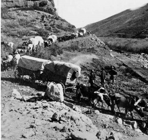wagon train on mountain trail
