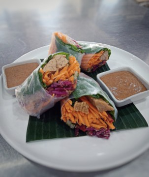 Tempeh Spring Rolls (Rice Paper Rolls Filled with Smoked Tempeh, Fresh Herbs, Carrot, Cucumber, Sauerkraut)