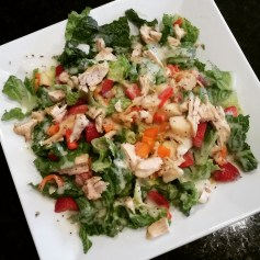 Poppyseed Chicken Salad: lettuce, spinach, 1 cooked & shredded chicken breast (you can cook however you prefer! I like to cook in the skillet with spices and slice), 1/2 orange pepper pieces, 1/2 red pepper pieces, 1 cup sliced strawberries, 1/4 cup walnuts or almond pieces, 3 tbs. poppyseed dressing!