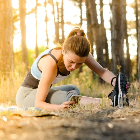 ways to boost metabolism, girl stretching