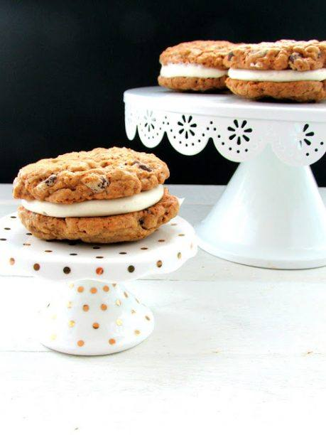 gluten free oatmeal creme pie on a cake plate with more on another cake plate