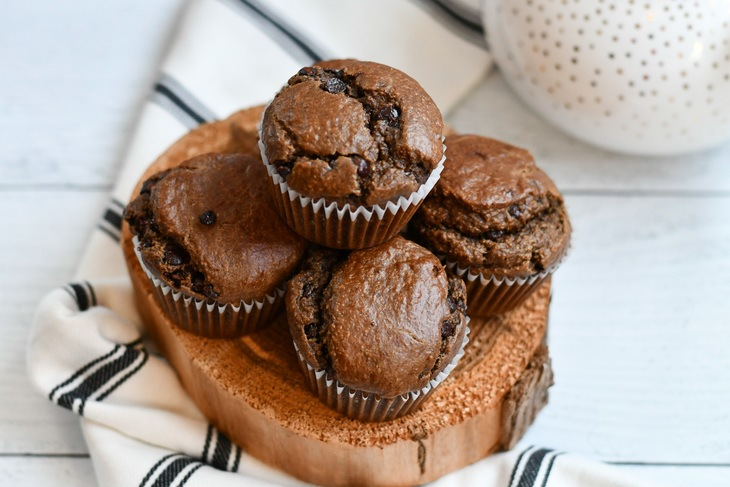 Chocolate Muffins stacked on a plate on a table