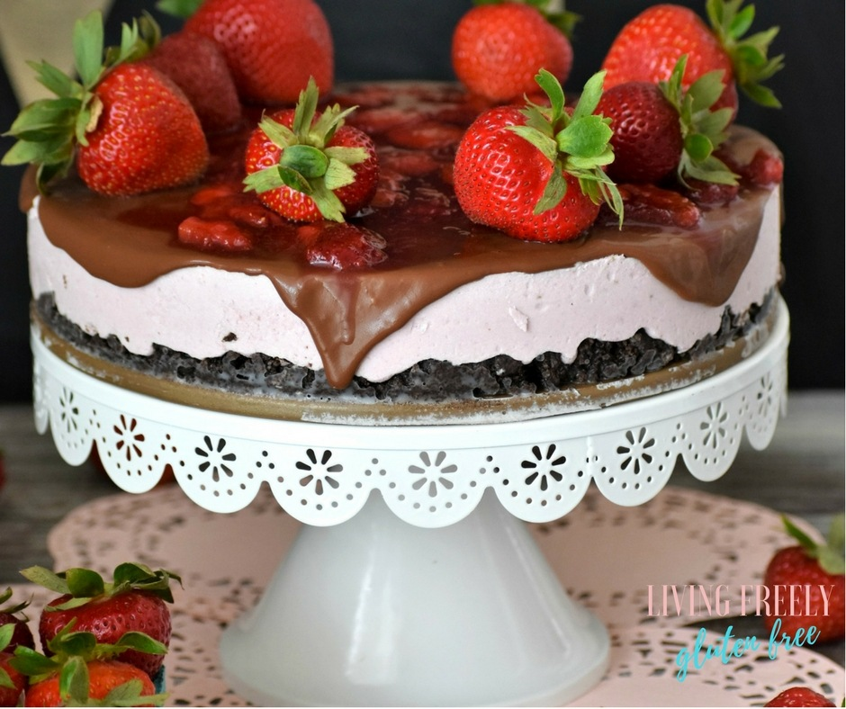 no bake strawberry cheesecake on a plate with fresh strawberries