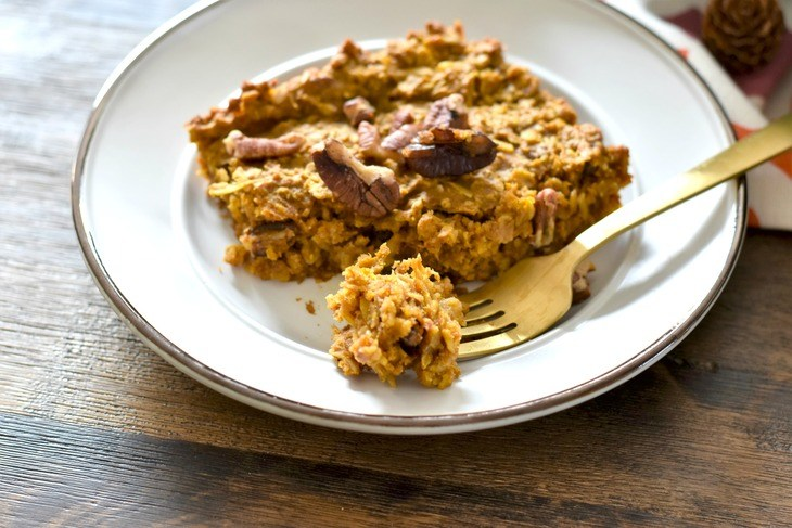 A slice of pumpkin spice baked oatmeal and a piece on a fork