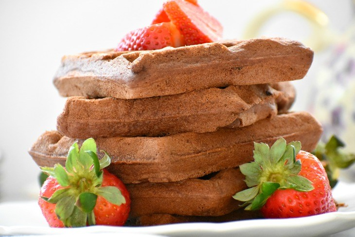 Paleo Chocolate Waffles stacked on a plate