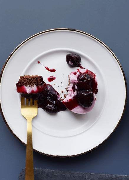 Easy No Bake Vegan Cheesecake Recipe on a plate with a bite on a fork