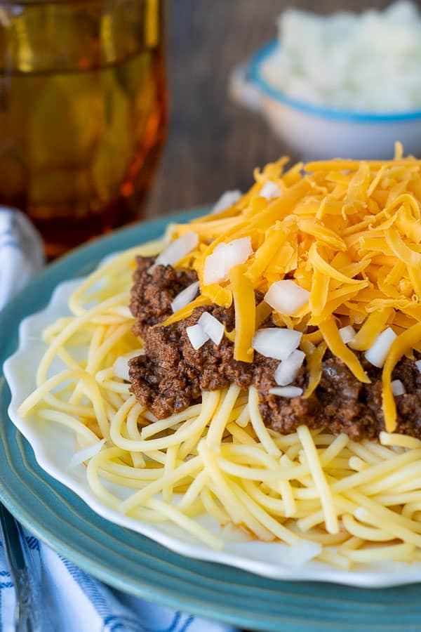 cheesy chili on top of spaghetti noodles