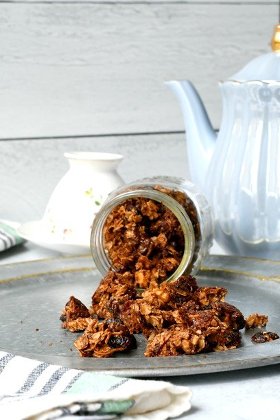 Vegan granola spilling out of a jar onto a plate