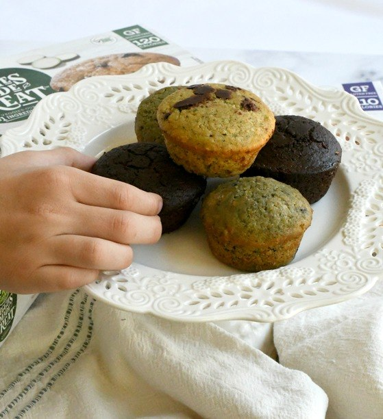 veggie muffins on a plate with someone picking one up