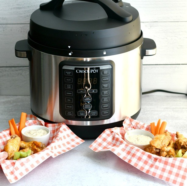 Crock pot with paleo wings and sauce