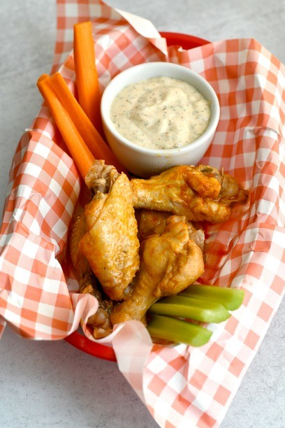 Wings in a basket with veggies and ranch