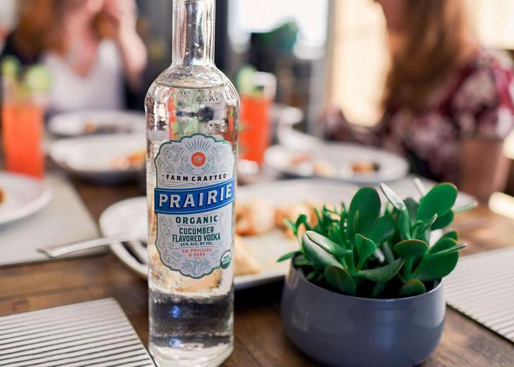 Bottle of Prairie on the kitchen table with us in the background
