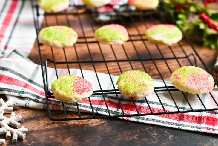 shortbread cookies covered in sprinkles on a cooling rack