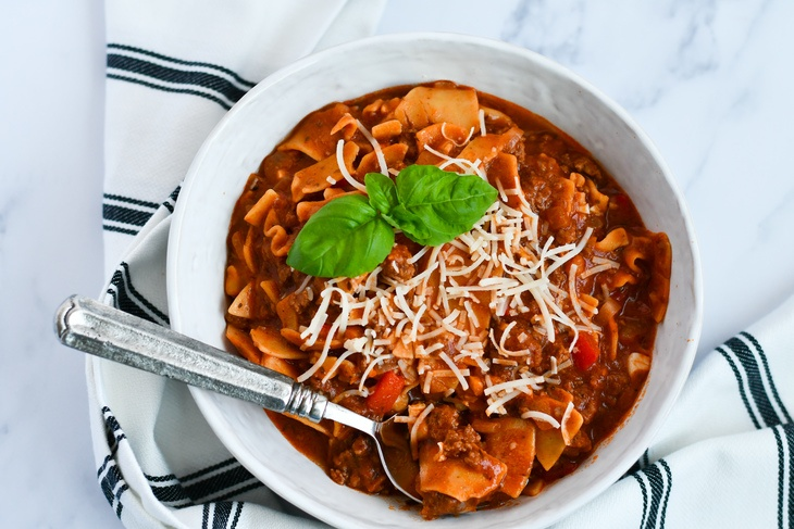 lasagna soup in a bowl on a table with a spoon