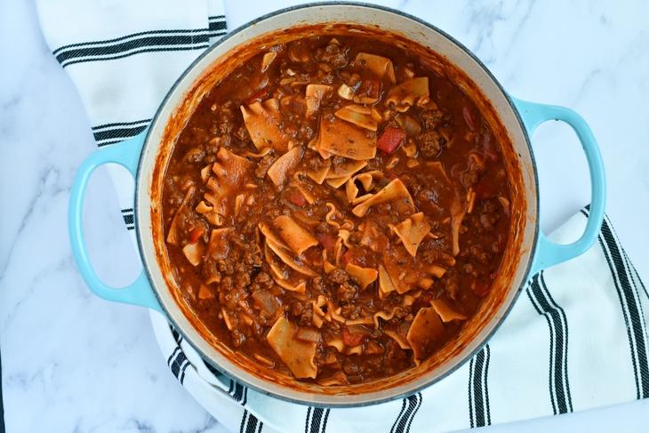lasagna soup in a pot i a table