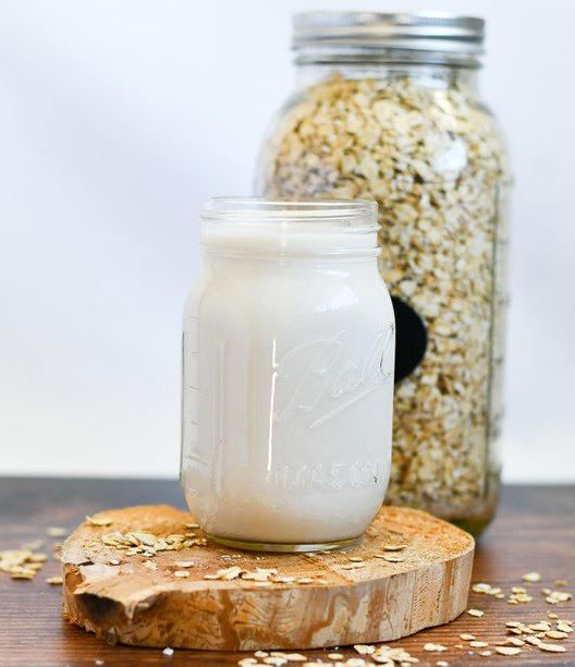 oat milk in a jar with a jar of oats