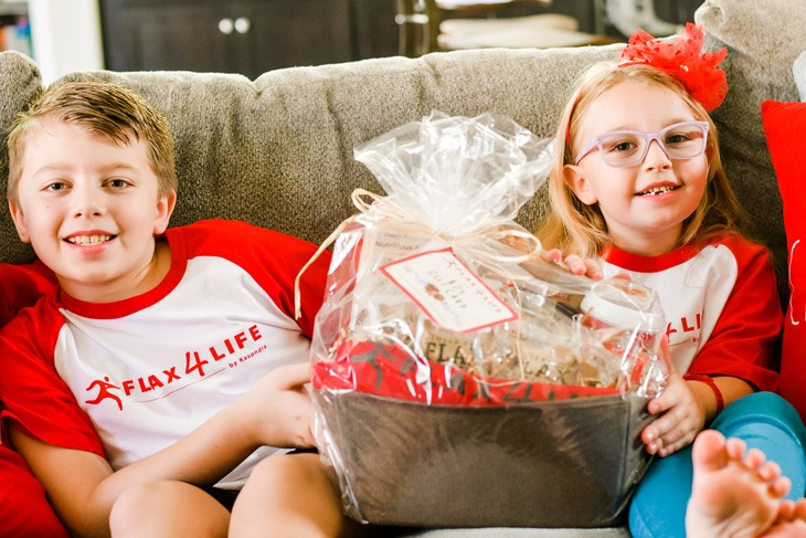 kids on couch with a basket of goodies