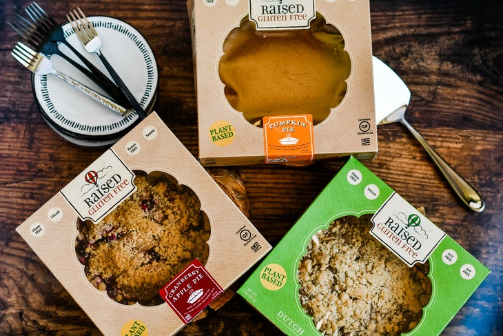 3 raised gluten free pies in the box on a table