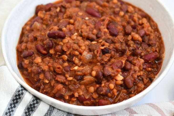 vegan bean chili in a bowl on a table with a towel